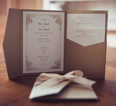 Beautiful wedding invitation with vintage edwardian details, in a gold pocket wallet.