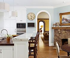 Island set up idea : lower level workspace with butcher block, higher level for eating with granite counter top.