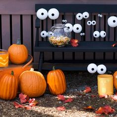 halloween decorations with styrofoam eyes on a bench and pumpkins - going to try with glow in the dark paint