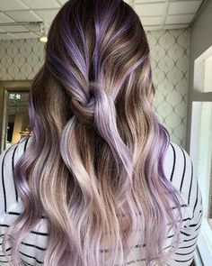 what 40 springtime hair color ideas are making us want to call our hairdressers right now! These lilac highlights are gorgeous against her brown hair! Any floral-inspired hair color is pretty much a good bet for spring. Lilac Hair, Hair Color Purple, Hair Dye Colors, Cool Hair Color, Brown Hair Colors, Try On Hair Color, Spring Hair Colors, Lavender Hair Dye, Purple Hair Streaks