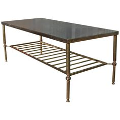 Elegant Brass and Glass Coffee Table | From a unique collection of antique and modern coffee and cocktail tables at https://www.1stdibs.com/furniture/tables/coffee-tables-cocktail-tables/