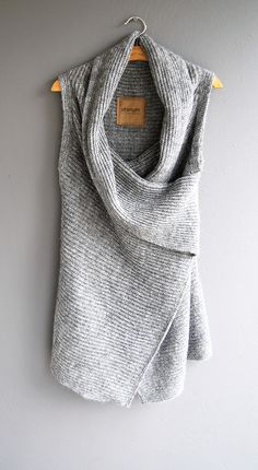 Sleeveless grey sweater wrap