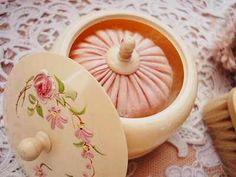 vintage celluloid powder jar with pink puff.