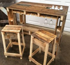 The Pallet Bar!! Complete with stainless beverage ice chests and wine glass holder. Also has a set of bar stools. Perfect!