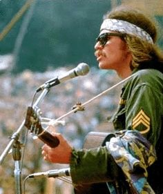 Country Joe at woodstock.THE FISH CHEER: .come on all you big strong men, uncle sam needs your help again.got himself in a terrible jam way down yonder in viet nam, so throw down your books & pick up a gun.we're gonna have a whole lot of fun. 1969 Woodstock, Woodstock Festival, Woodstock Hippies, Woodstock Music, Woodstock Photos, Rock Music, My Music, Sound Music, Rock N Roll