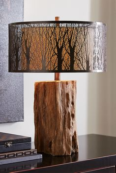 Nothing suggests winter serenity like the stark silhouette of bare birch trees. This Etched Birches Lamp from Pier 1 is no exception, with its raw log-like base and birch shade that casts a peaceful glow from any side table. Laser-cut iron creates a landscape of tree trunks, with a hand-painted bronzed finish and inner linen liner to spread the light. Forecast: Serene.