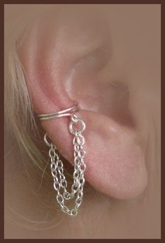 Hey, I found this really awesome Etsy listing at http://www.etsy.com/listing/87642875/ear-cuff-pair-with-double-chain-wrap