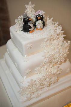 Snowflake wedding cake with penguin toppers