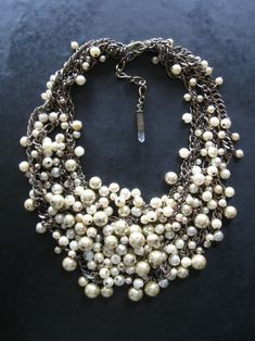 Love the beaded pearls, crystal charm, and vintage look of this piece.      THIS BEADIFUL WORLD...