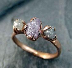 This raw pink diamond trio ring: