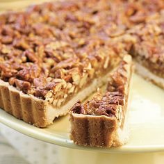Caramel-Pecan Tart Recipe | Surprisingly easy to make, this pecan and caramel dessert recipe pairs the cookie-like crispness of shortbread with a buttery-rich brown sugar-and-honey topping. #Thanksgiving Dessert Recipes