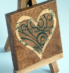 art easel with heart with music notes cake topper