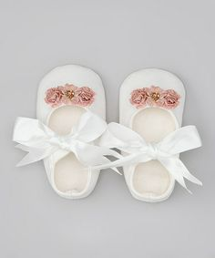 White Flower Mary Janes by Truffles Ruffles #zulily #zulilyfinds  Love. Love. Love. Shoe obsessions start young
