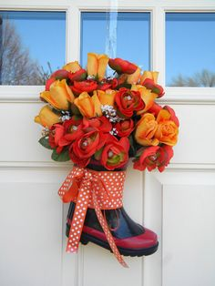 This is my son's rain boot turned into a great spring Front door decoration. I put craft flowers in it but you can use fresh flowers too since the boot will hold a small amount if water! What…
