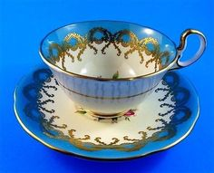 Stunning Pink Rose Center with Gold and Blue Border Aynsley Tea Cup & Saucer Set