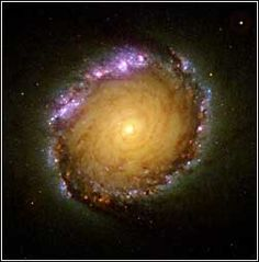 When you look into the barred spiral galaxy, NGC 1512, it almost looks like the Star Wars depiction of traveling through hyperspace.