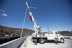 March 29, 2017 - Workers install an energy-efficient lighting fixture on the Rockland approach.