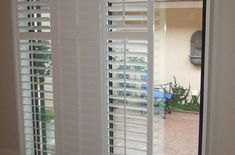 Sliding Shutters modernize your sliding glass patio door and are a great alternative to vertical bli Patio Door Shutters, Sliding Door Curtains, Sliding Screen Doors, Curtains With Blinds, Replacement Sliding Screen Door, Bedroom Ideas For Teen Girls Small, Traditional Curtains, Horizontal Blinds, Grey Doors