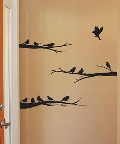 Add a natural touch to your living room or bedroom with this bird-themed wall decal.