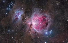 The Orion Nebula - The image highlights the structure, giving a sense of vast cavities filled with pink hydrogen gas and the blue haze of reflected starlight.