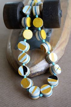 recycled skateboard necklace.