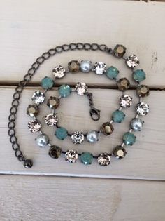 Swarovski crystal 8 mm necklace; pacific opal, bronze, silk, crystal and pearl accents