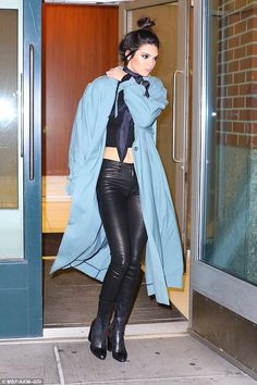 Working it: Kendall Jenner stepped out in leather pants with matching boots and a crop top in NYC on Tuesday night as she showcased her incredibly slim and toned physique