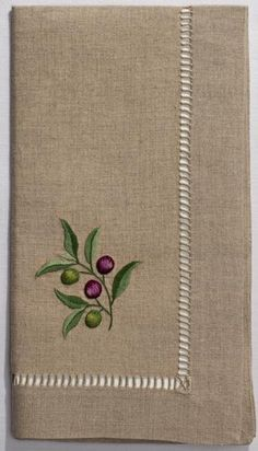 Hand embroidered dinner napkin on 100% linen, finished by hand with a grande…