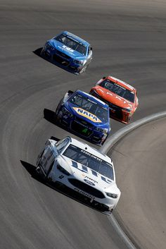 Chase Elliott Photos Photos - Brad Keselowski, driver of the #2 Miller Lite Ford, leads Chase Elliott, driver of the #24 NAPA Auto Parts Chevrolet, during the NASCAR Sprint Cup Series Kobalt 400 at Las Vegas Motor Speedway on March 6, 2016 in Las Vegas, Nevada. - NASCAR Sprint Cup Series Kobalt 400