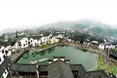 Bird's eye view of Longmen Old Village.The ancient awaits your discovery. World Economic Forum, Annual Meeting, Global Economy, Why People, Birds Eye View, Geography, Switzerland, English, Mansions