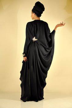 This is why learning how to drape fabrics is so important. This MALAAK 2010 draped abaya is lovely and the draping not only hides the figure, but also adds elegance.