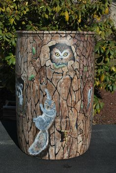 This rain barrel was painted as a tree trunk for a Rotary Club fundraiser.