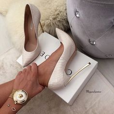 CASADEI white pumps with gold heels