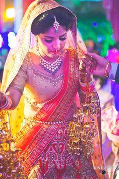 She's so cute shy ...🤗Photo by Tushar Roy Photography, Gurgaon #weddingnet #wedding #india #indian #indianwedding #weddingdresses #mehendi #ceremony #realwedding #lehenga #lehengacholi #choli #lehengawedding #lehengasaree #saree #bridalsaree #weddingsaree #indianweddingoutfits #outfits  #photoset #details #sweet #cute #gorgeous #fabulous #jewels #rings #tikka #earrings #sets #lehnga