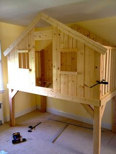 James would seriously love this. I think there would be room for a toddler bed underneath, as well. Bunk Bed Fort, Playhouse Loft Bed, Kid Loft Beds, Treehouse Loft Bed, Kid Beds, Indoor Playhouse, Bed Ideas For Kids, Unique Kids Beds, Diy For Kids
