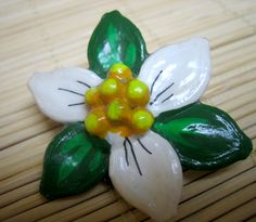 peppercorn and pumpkin seed trillium flower brooch