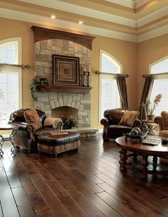 Nice look. Best 10 Stunning Tuscan Living Room Designs : Astonishing Beige Tuscan Style Living Room Design with Wonderful Wooden Round Coffee Table and Brown Leather Sofa also Nature Stone Frame Fireplace Tuscan Living Rooms, Home Living Room, Living Room Designs, Living Room Decor, Dining Rooms, Living Area, Style Toscan, French Style, Tuscan Design