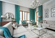 Beautiful Transitional style teal living room decor with transitional tufted sofas, teal decor, turquoise living room decor, modern beach house style living room