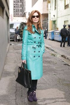 dr megan hunt (body of proof) favours great tailoring such as this Burberry turquoise leather trench coat, structured handbags and mega high heels
