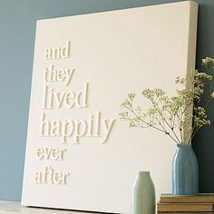 Wood letters glued to canvas then all painted a solid color. - this would be an adorable wedding gift!