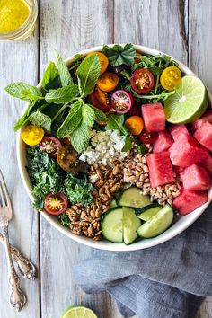 Early summer salad with kale, arugula, watermelon and farro | Vegan (option) and vegetarian. | Click for healthy recipe. | Via  HonestlyYUM (http://honestlyyum.com)