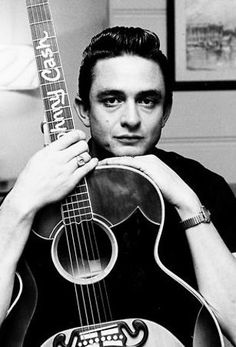 Johnny Cash.    Suggested Listening: Get Rhythm.    Or anything else, for that matter.
