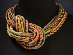 Necklace |  Susan Sanders.  'Silkworm'.  Silk and felt.