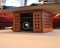 Concealed front projector in the coffee table.