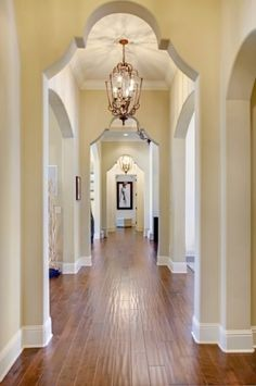 This long hallway is saved from feeling enclosed and boring with the addition of a series of trefoil archways creating perspective. (via Long Corridor - mediterranean - hall - other metros - by Sunscape Homes, Inc) Beautiful Interiors, Beautiful Homes, Beautiful Kitchen, Pale Yellow Walls, Neutral Walls, Interior Styling, Interior Design, Hallway Designs, Entry Hall