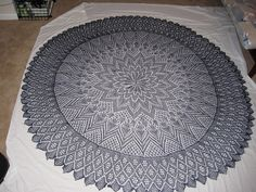 Dramatic, more than circular lace shawl is a masterpiece of the knitter's art.
