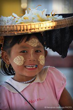Girl with chewing gum. Mandalay, Myanmar