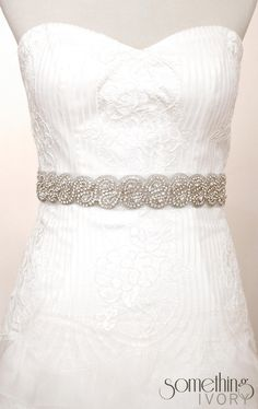 Love beaded/jewelled belts on wedding gowns!