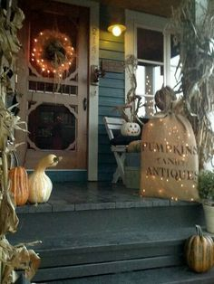 Fall decorations...I'm loving the screen door!