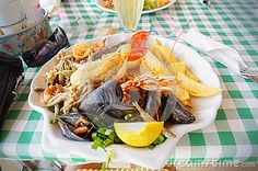 Plate with seafood and fries at the restaurant